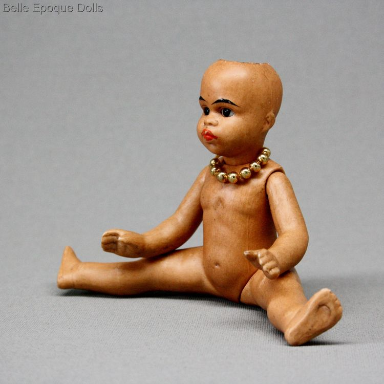 antique mulatto Gebruder Kuhnlenz doll , Antique Dollhouse miniature , light brown complexioned all bisque doll