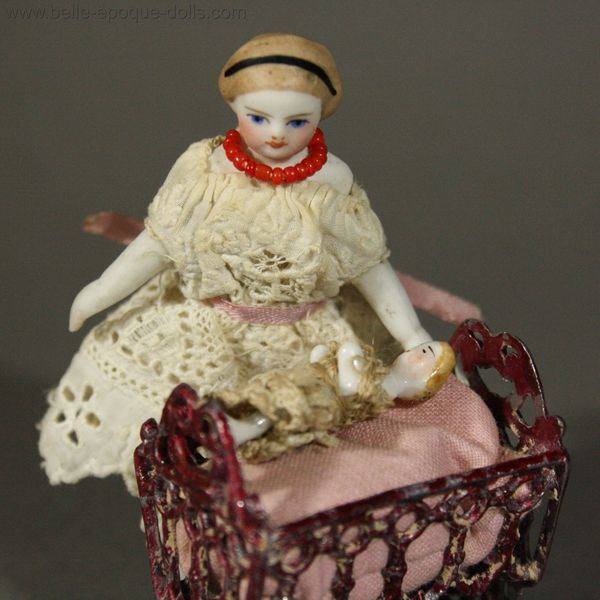 ... watching her Frozen Charlotte Doll in its Soft Metal Cradle - Ref P306
